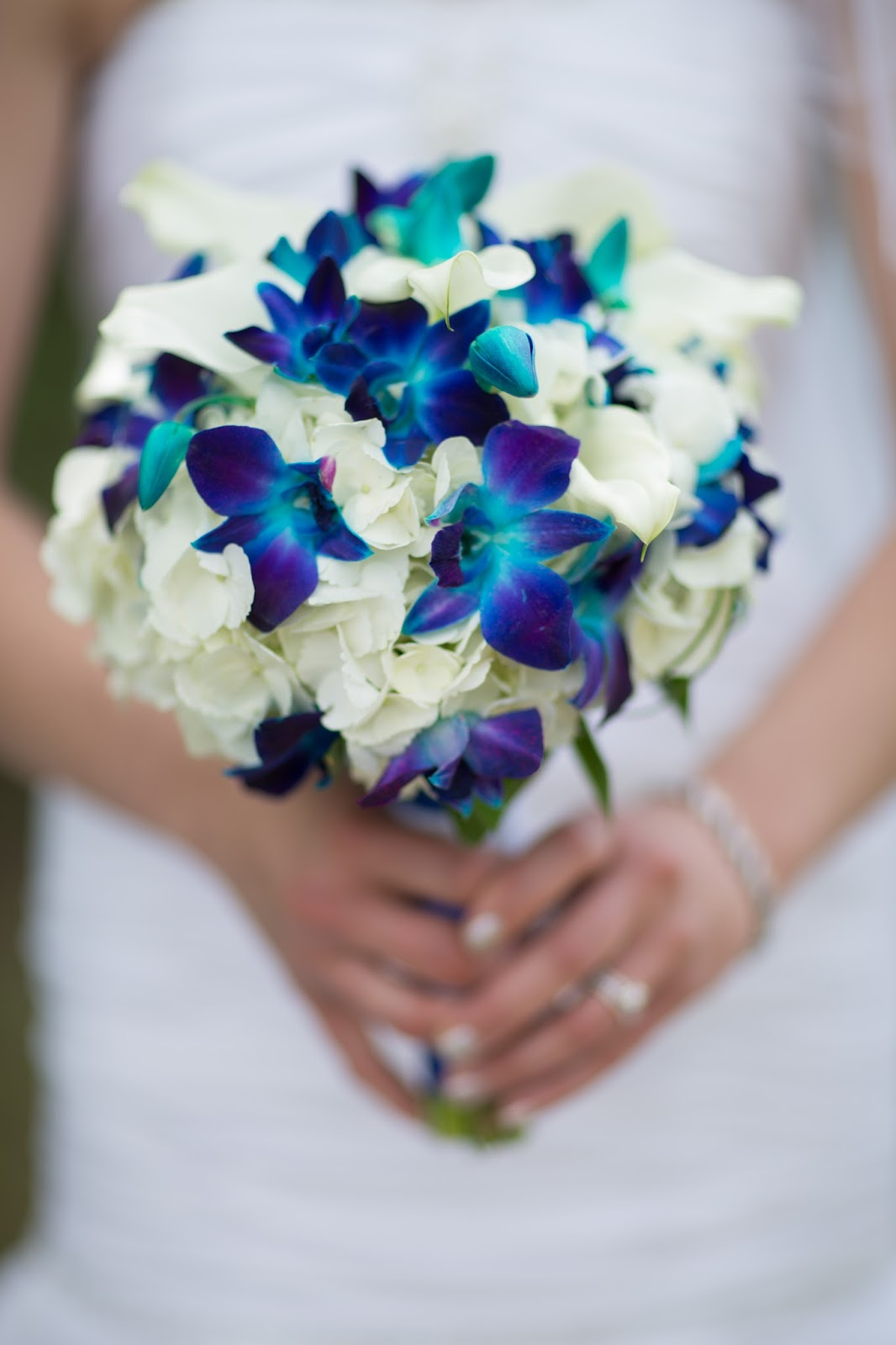blue orchid bouquets wedding photo - 1