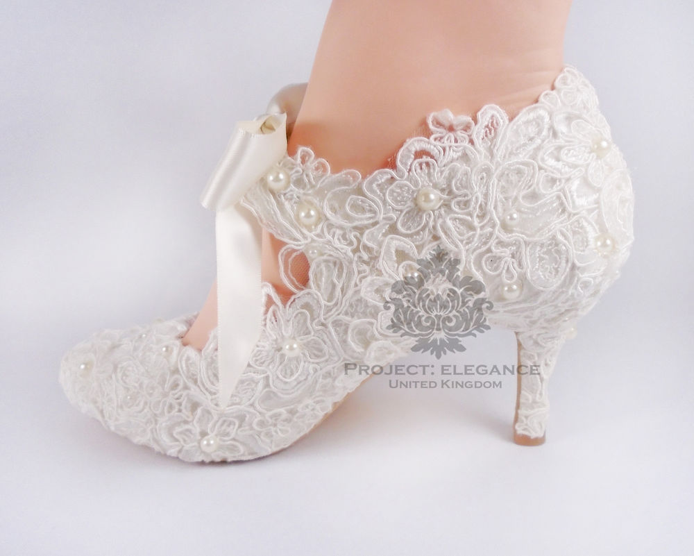 ivory bridal shoes low heel photo - 1