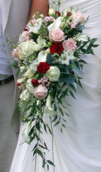 red and yellow wedding bouquets photo - 1