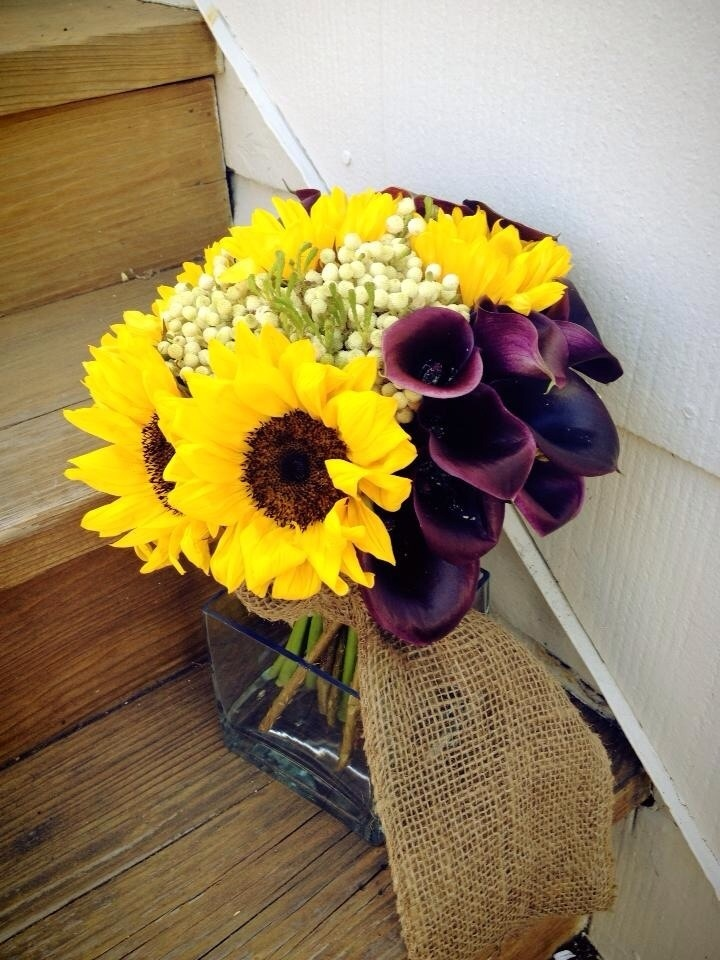 wedding bouquets with sunflowers and purple flowers photo - 1