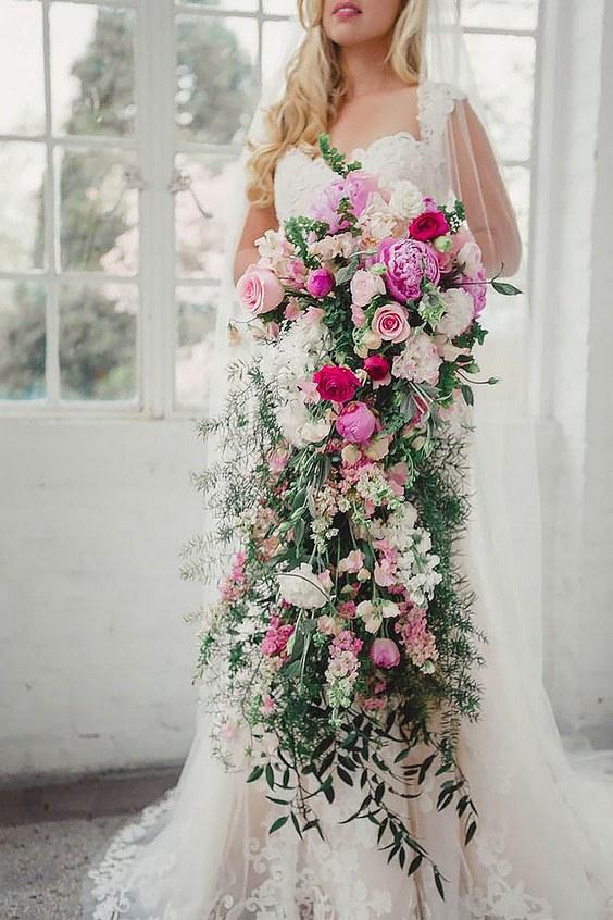 white cascading wedding bouquets photo - 1