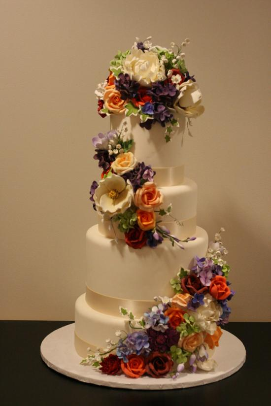white wedding cake with flowers photo - 1