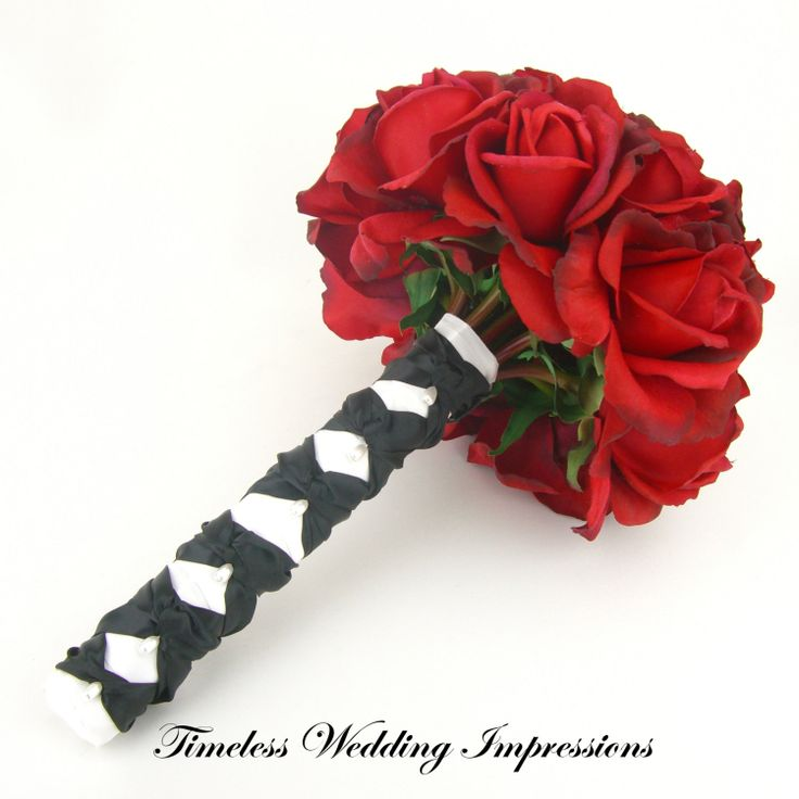 red black and white bouquets wedding photo - 1