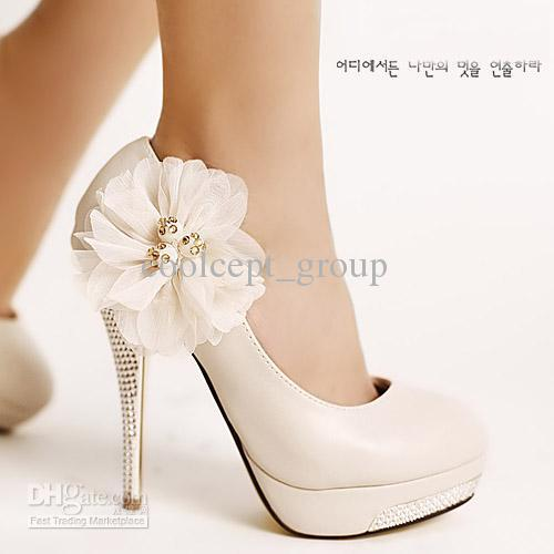 white bridal shoes high heel photo - 1