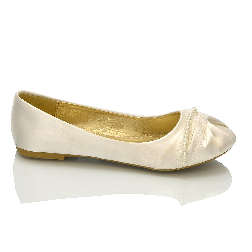 white flat bridal shoes photo - 1